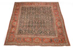 A NORTH WEST PERSIAN CARPET, approximately 332 x 288cm