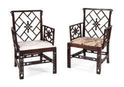 A PAIR OF GEORGE III MAHOGANY COCKPEN ARMCHAIRS IN THE CHINESE CHIPPENDALE MANNER, CIRCA 1770