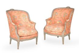 A PAIR OF GREY PAINTED AND UPHOLSTERED TUB ARMCHAIRS, IN LOUIS XVI STYLE