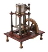 A well engineered period model of a vertical live steam colliery type engine