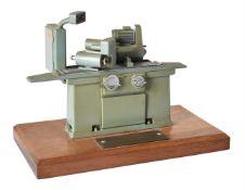 A metal model of an engineering workshop surface grinder