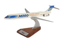 An aircraft manufacturers desk top model of a McDonnell Douglas MD90 passenger plane