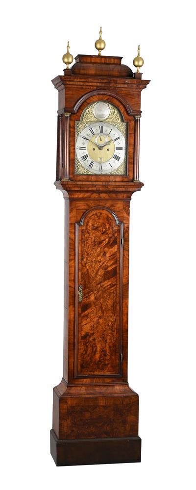 A GEORGE I FIGURED WALNUT EIGHT-DAY LONGCASE CLOCK