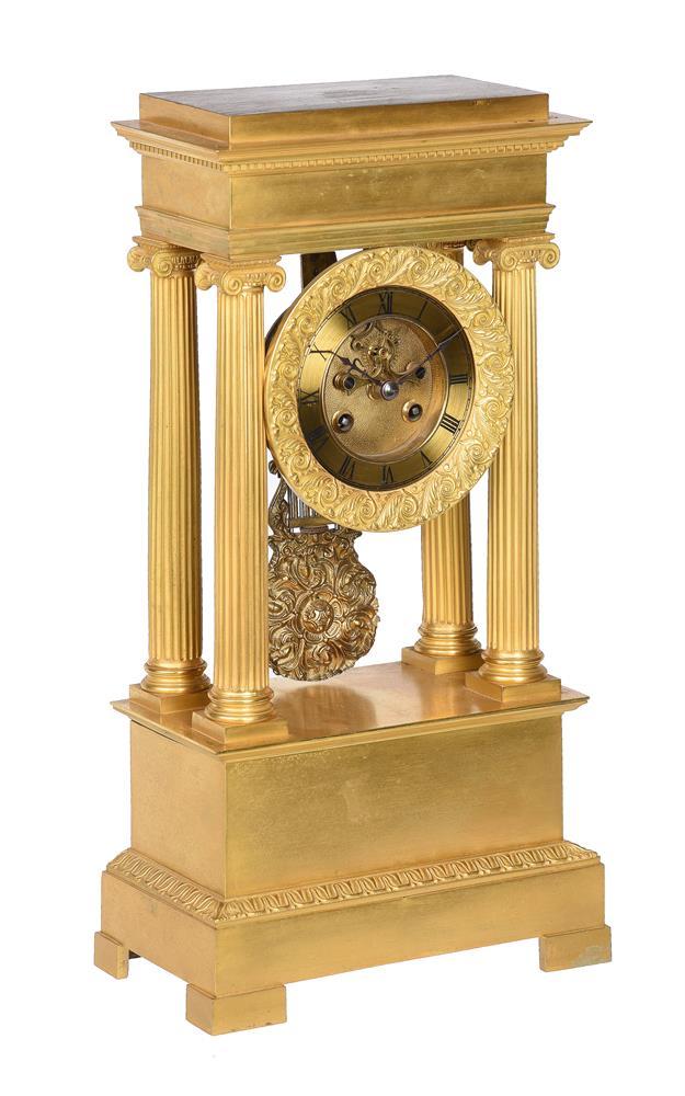 A FRENCH CHARLES X STYLE ORMOLU PORTICO MANTEL CLOCK
