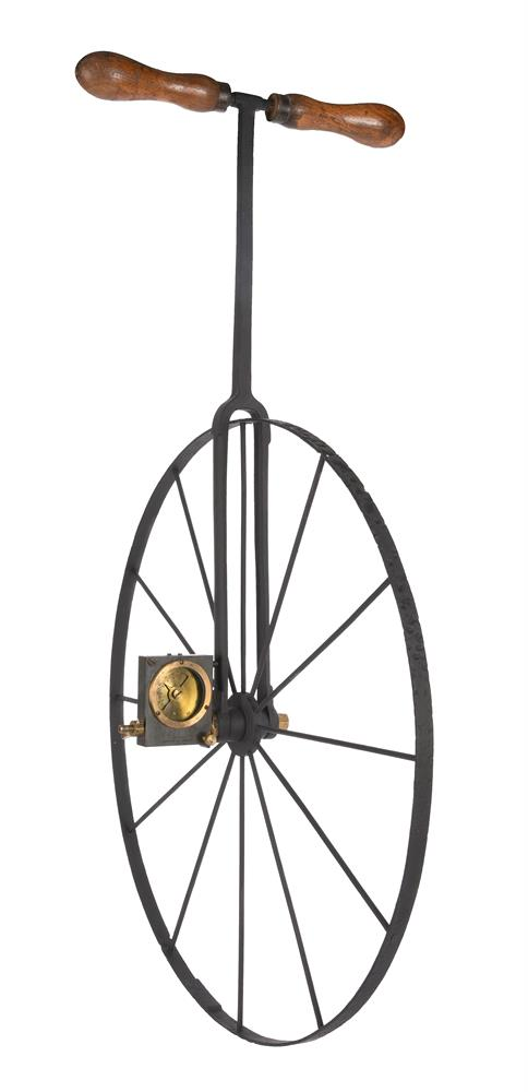 A RARE VICTORIAN WROUGHT IRON AND BRASS WAYWISER OR HODOMETER