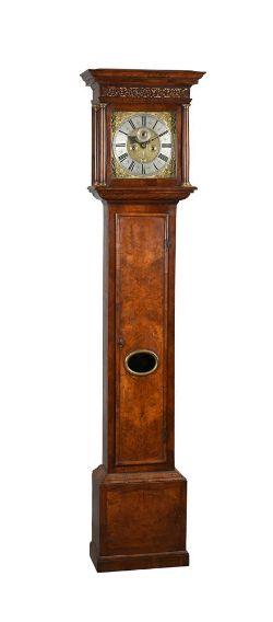 A WILLIAM III WALNUT EIGHT-DAY LONGCASE CLOCK