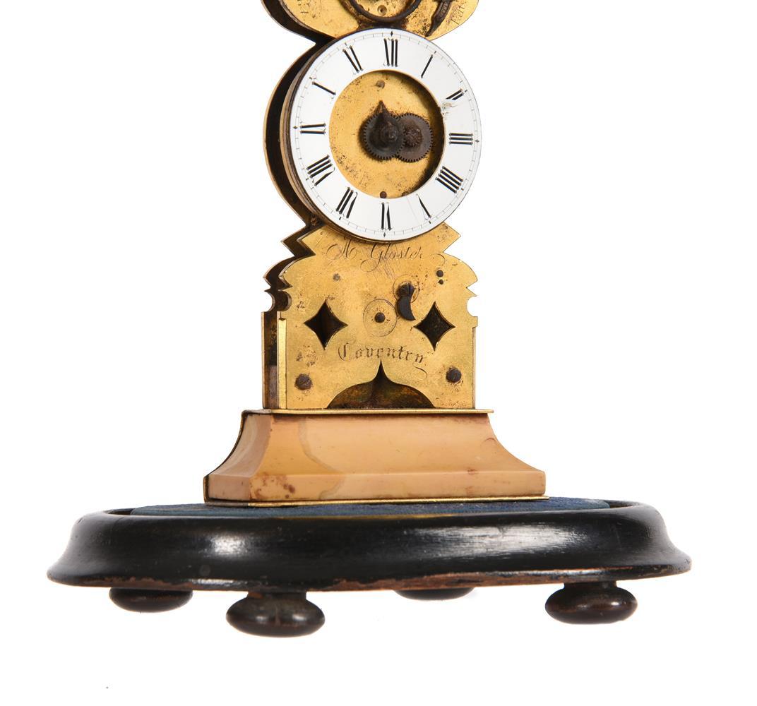 AN UNUSUAL VICTORIAN GILT BRASS MINIATURE SKELETON TIMEPIECE - Image 3 of 4