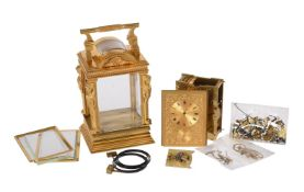 A FINE GILT BRASS CARIATIDES CASED GRANDE-SONNERIE STRIKING AND REPEATING ALARM CARRIAGE CLOCK