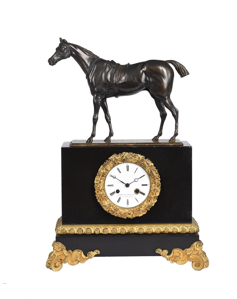 A FRENCH LOUIS PHILIPPE PATINATED BRONZE AND ORMOLU MOUNTED BELGE NOIR MARBLE MANTEL CLOCK