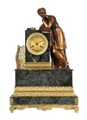 A FRENCH EMPIRE ORMOLU AND VERDE ANTICO MARBLE FIGURAL MANTEL CLOCK