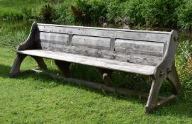 A LARGE REFORMED GOTHIC STYLE WOODEN BENCH, CIRCA 1870