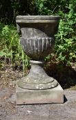 A CARVED YORK STONE URN CENTREPIECE, EARLY 19TH CENTURY