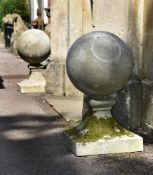 A LARGE PAIR OF COMPOSITION STONE BALL FINIALS, 20TH CENTURY