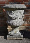 A COMPOSITION STONE URN, 20TH CENTURY
