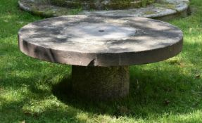 A CIRCULAR LOW TABLE WITH STONE TOP AND GRANITE BASE, 19TH CENTURY AND LATER