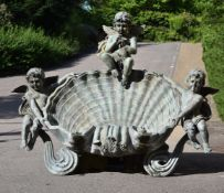 A LARGE BRONZE PUTTI AND SHELL WALL FOUNTAIN, 20TH CENTURY