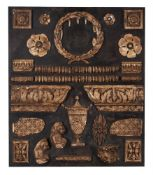 A MOUNTED BOARD OF PLASTER FRAGMENTS, EARLY 20TH CENTURY