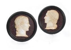 A PAIR OF ITALIAN WHITE MARBLE RELIEF PORTRAITS OF JULIUS CAESAR AND HIS WIFE CALPURNIA