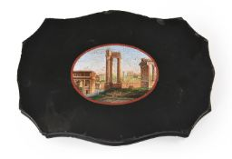 AN ITALIAN MICROMOSAIC PAPERWEIGHT DEPICTING THE ROMAN FORUM WITH THE TEMPLE OF CASTOR AND POLLUX