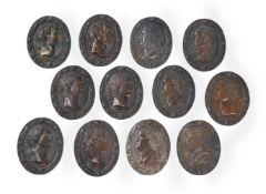 A SET OF TWELVE ITALIAN BRONZE OVAL PLAQUES OF ROMAN EMPERORS, LATE 18TH/EARLY 19TH CENTURY