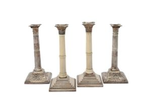 Y A pair of George III silver candlesticks by John Winter & Co.
