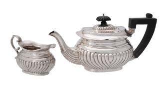 A silver half gadrooned oblong tea pot and cream jug by A. & J. Zimmerman