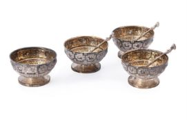 A set of four Victorian Scottish silver circular salts by Hamilton & Inches