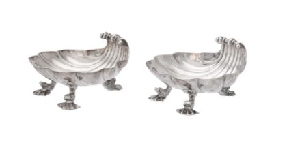 A pair of George II silver shell shaped butter dishes by Christian Hillan