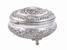 An Egyptian silver coloured circular hinged box and cover