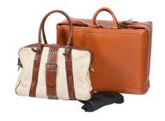 Louis Vuitton, a tan leather travel case