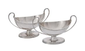 A pair of George III oval twin handled salt cellars by Henry Chawner