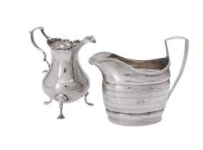 Two silver cream jugs