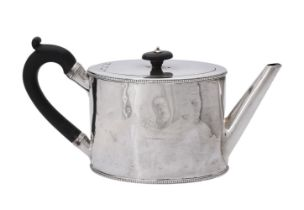 A George III silver oval straight-sided tea pot by William Vincent