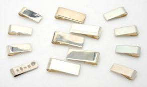 A collection of silver plain rectangular money clips
