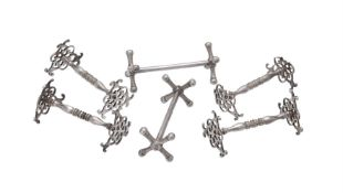 A set of four William IV silver knife rests by Benjamin Stephens