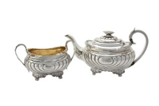 Y A late George III silver oblong baluster tea pot and sugar basin by William Barret II