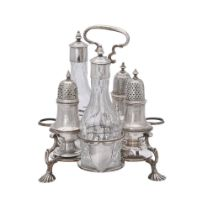 A George II silver Warwick cruet stand with associated bottles and casters