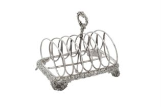 A George IV silver six division toast rack by Joseph Angell I