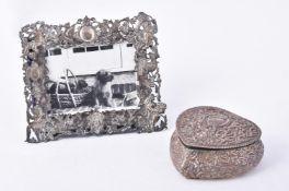 A silver heart shaped jewellery box by James Deakin & Sons