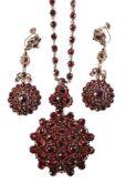 A late 19th century Bohemian garnet necklace and similar ear pendants