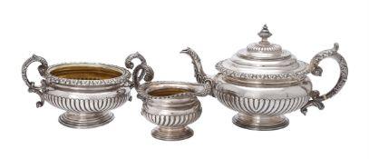 Y A George IV silver three piece circular tea set by S. C. Younge & Co.