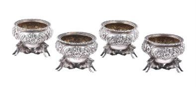 A set of four Victorian silver circular salts by Joseph Angell I & Joseph Angell II