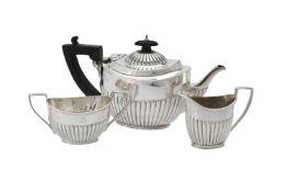 A Victorian silver oval half lobed three piece tea set by W. & G. Sissons