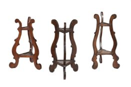 A harlequin group of three beech and walnut triangular two tier stands