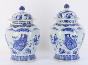 A pair of Chinese blue and white vases and covers