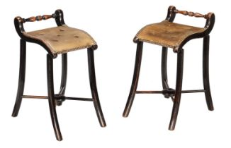 A pair of late Victorian ebonised Cellists' stools
