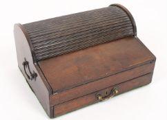 An early 19th century tambour top mahogany writing box