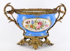 A French porcelain gilt metal mounted Sevres-style table centrepiece