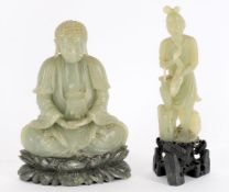 A Chinese celadon soapstone buddha and carved soapstone figure of a fisherman