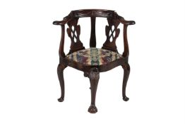 A Mid-18th century and later carved mahogany corner chair